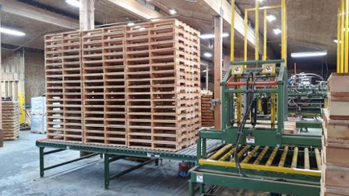 Built pallets ejected from the roll out table ready for use.